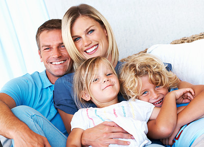 Buy stock photo Portrait of beautiful middle aged couple with children having fun at home
