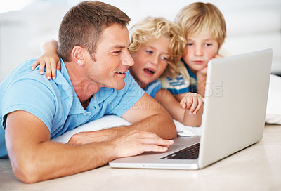 Buy stock photo Closeup of middle aged man with children using laptop at home