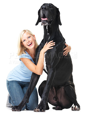 Buy stock photo Cute young pet owner sitting alongside her great dane and laughing while isolated on white - portrait
