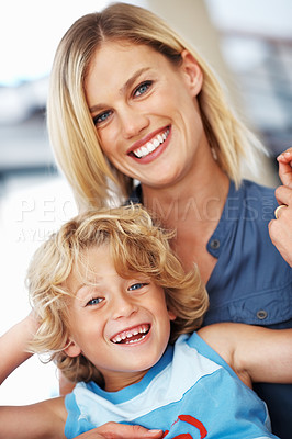 Buy stock photo Portrait of beautiful Caucasian woman smiling with adorable little son
