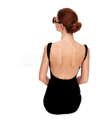 Buy stock photo Rearview of a stylish woman wearing a black dress sitting on the floor