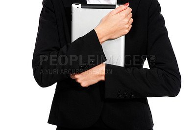 Buy stock photo A young businesswoman holding her digital tablet close to her chest