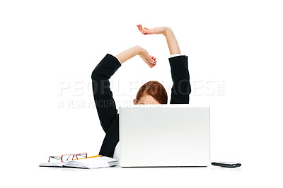 Buy stock photo A young businesswoman stretching her arms behind a laptop