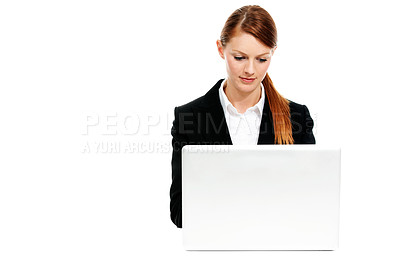 Buy stock photo A young businesswoman sitting at her laptop and working