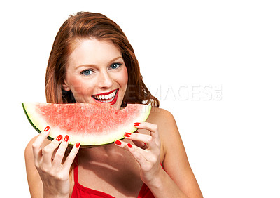 Buy stock photo Portrait of a young woman biting a fresh piece of watermelon