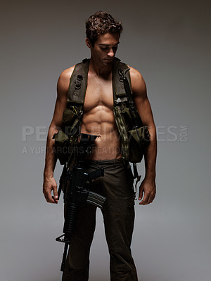 Buy stock photo Handsome young soldier with a bare chest carrying an M16 rifle