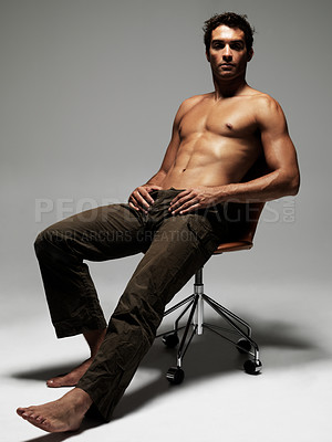 Buy stock photo Handsome topless young man reclining in an office chair - portrait