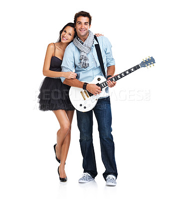 Buy stock photo Adoring young woman embracing a trendy male guitarist - portrait