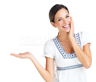 Buy stock photo Lovely brunette smiles and gestures towards the copyspace next to her