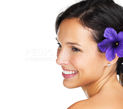 Buy stock photo Close-up of a beautiful brunette with a purple flower behind her ear - copyspace