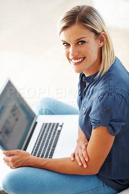 Buy stock photo Portrait of gorgeous Caucasian woman smiling while using laptop