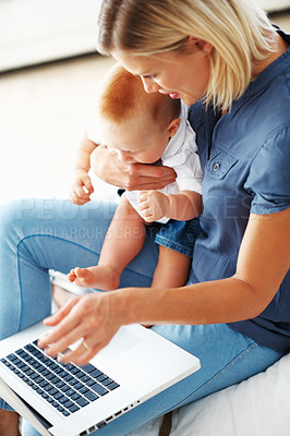 Buy stock photo Smiling Caucasian woman using laptop with cute little baby