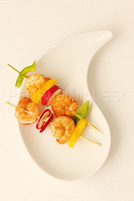 Buy stock photo Closeup of two prawn skewers on a white background