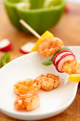 Buy stock photo Closeup of a prawn skewer placed on a plate