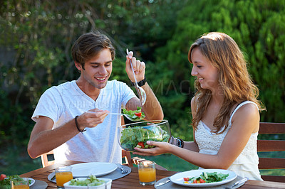 Buy stock photo Young teen couple sharing a healthy lunch together