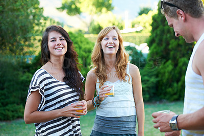 Buy stock photo Young teens enjoying a social gathering outdoors with a laugh and a smile - portrait