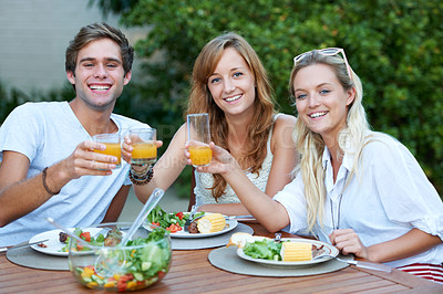 Buy stock photo Smiling young people having lunch together - portrait