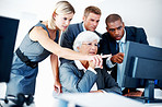 Tensed business team looking at computer while discussing