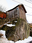 Old wooden cabin on a rocky outcrop