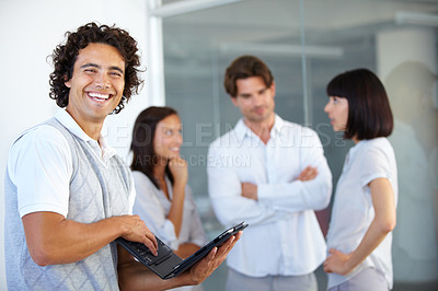 Buy stock photo A group of successful young entrepreneurs standing together and having a discussion