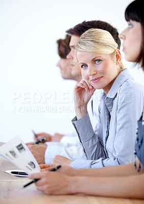 Buy stock photo Portrait of a pretty businesswoman smiling at the camera during a boardroom meeting