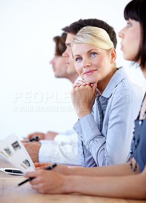 Buy stock photo Portrait of a pretty businesswoman smiling during a meeting