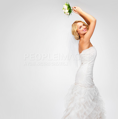 Buy stock photo Gorgeous young bride getting ready to throw her bouquet