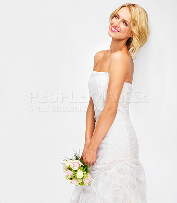 Buy stock photo Pretty young bride holding her bouquet
