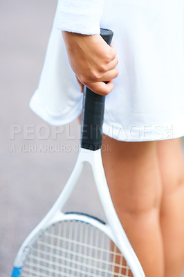 Buy stock photo Cropped view of a young female tennis player holding a tennis racquet