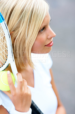 Buy stock photo A young female tennis player with her racquet and ball in her hand