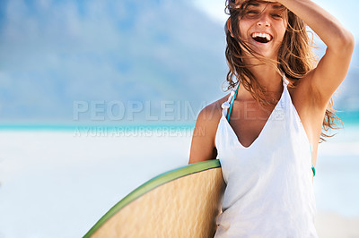 Buy stock photo Beautiful girl sweeping her hair off her face holding her surf board before hitting the waves - copyspace