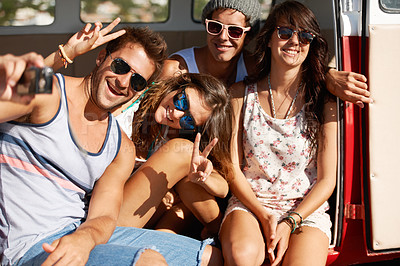 Buy stock photo Four friends fooling around for a snapshot photo in the summer sun
