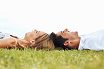 Happy couple lying together on grass