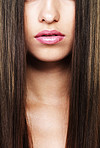 Luscious lips framed with perfect skin and rich, healthy hair