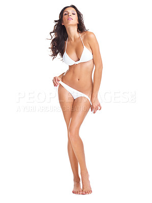 Buy stock photo Studio portrait of a gorgeous young woman posing in a white bikini while standing against a white background