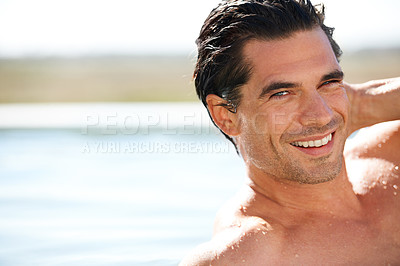 Buy stock photo Portrait of a sexy young man in a swimming pool running his hand through his hair