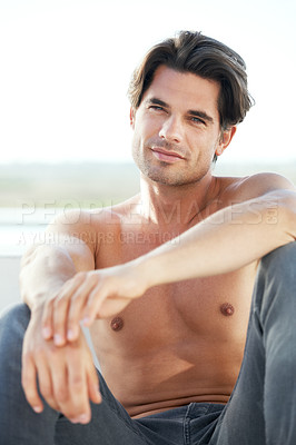 Buy stock photo A sexy young man without a shirt gazing into the distance