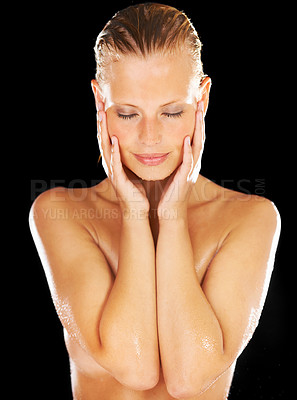Buy stock photo Stunning young woman caresses her cheeks after her shower - Isolated on black