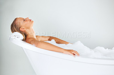 Buy stock photo Pretty young woman taking ease as she relaxes in her bath