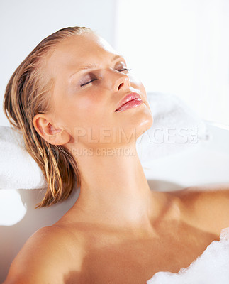 Buy stock photo Young beauty bathing while she relaxes