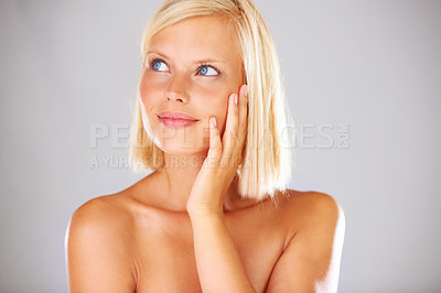 Buy stock photo Gorgeous young woman looking away while isolated on grey