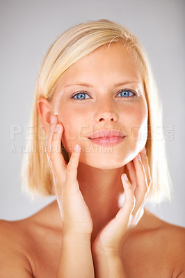 Buy stock photo Closeup of a gorgeous young womans face with bright blond hair