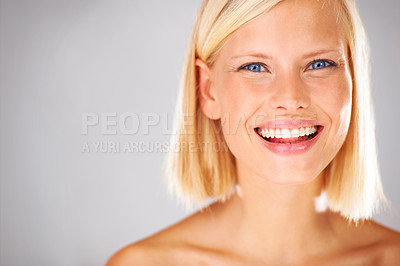 Buy stock photo Portrait of a pretty young woman with a large grin and copyspace beside her