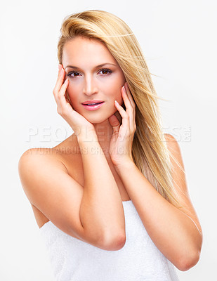 Buy stock photo Portrait of a beautiful blonde woman with flawless skin looking shower-fresh while gazing at you, isolated on white