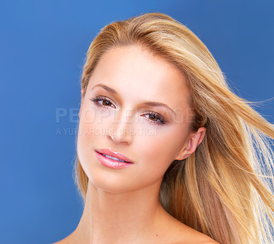 Buy stock photo Isolated portrait of a gorgeous blonde woman with a naturally radiant complexion gazing at you