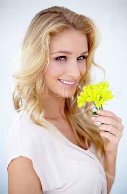 Buy stock photo Portrait of a pretty young woman holding a yellow flower - Isolated on white