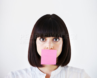 Buy stock photo Conceptual image of a young businesswoman with a pink post-it note covering her mouth
