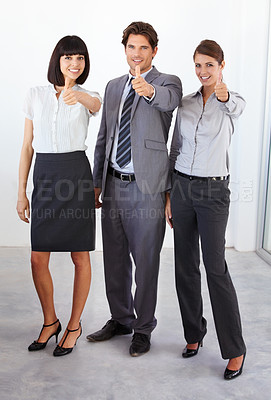 Buy stock photo Full-length portrait of three young executives giving you the thumbs-up