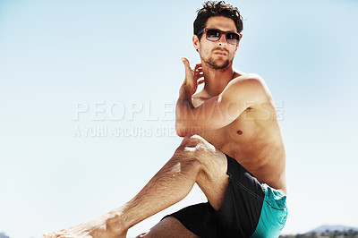Buy stock photo Young male wearing sunglasses and scratching his neck on a sunny summer day - Copyspace