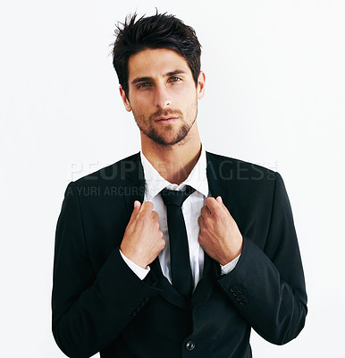 Buy stock photo Portrait of a suave and sexy male holding onto his black jacket staring at the camera
